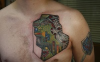 Beautiful colorful electronic circuit tattoo on chest